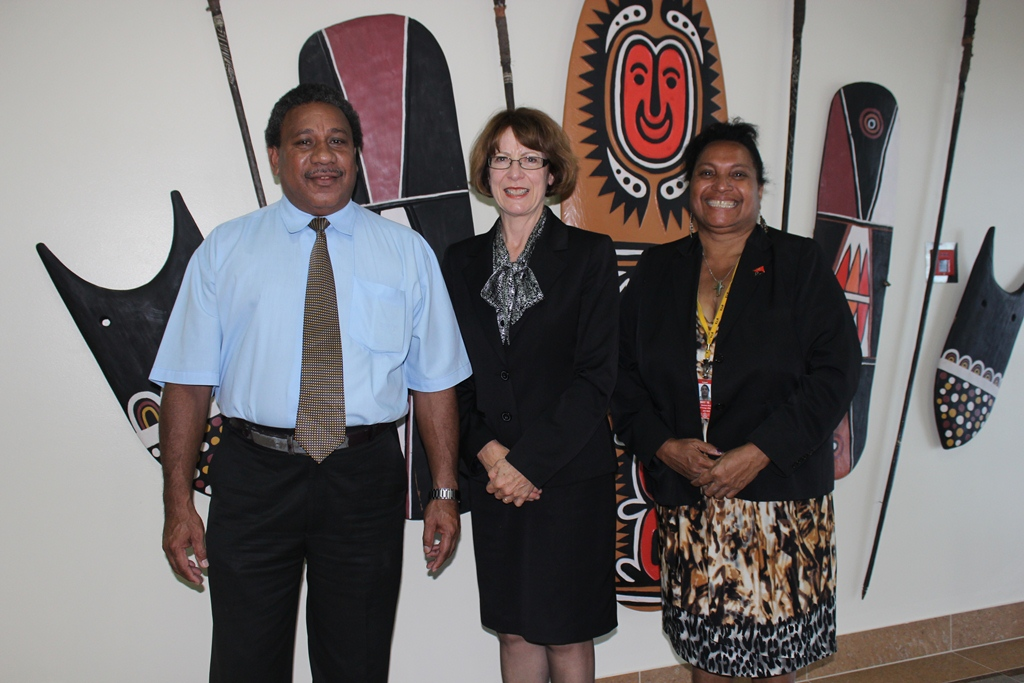 Australian High Commissioner Deborah Stokes is welcomed to PNG by Chief of Protocol Jimmy Ovia and DFAT Protocol Director Barbara Mimino.