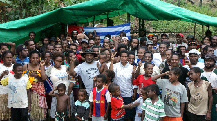 Benny Wenda pictured with West Papuan refugees at their camp in Papua New Guinea.There are now over 10,000 West Papuan refugees living in PNG, with more crossing the border daily seeking safety from ongoing Indonesian military operations against the civilian population.
