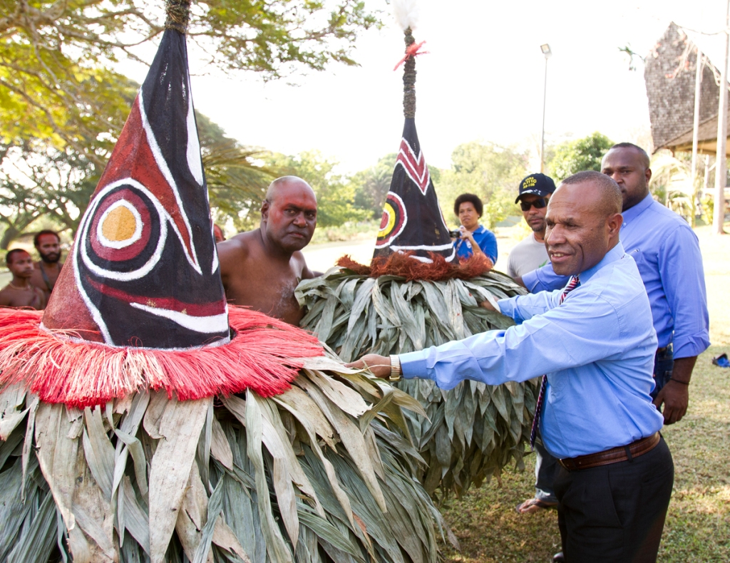 TWO TUMBUAN NEW IRELAND MASKS DONATED TO NATIONAL MUSEUM AND Minister for Tourism Arts & Culture, Boka Kondra receiving the masks from Tumbuan Chief Cletus NgaffkinART GALLERY