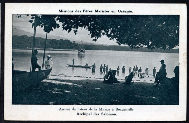 1900-1930, Postcard, in Teop Bay, Bougainville, 16 Indigenous Boys Wade in the Water near the Shore, while a handful of European Men stand on the Land near Boats, A larger Boat is visible on the Water Sailing towards the Shore, PNG BOUGAINVILLE, Mission of Northern Solomons, Unknown Photograther (image provided by Peter John Tate)