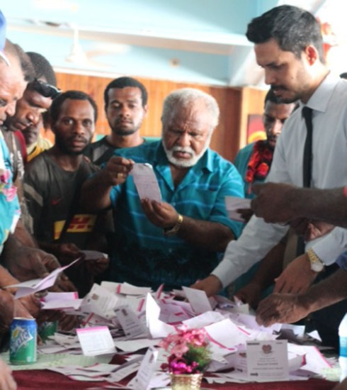 Madang By-Election candidates inspecting the 10,000 valid ballot papers